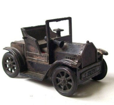 This is a Model T Ford pencil sharpener from RecycleBuyVintage. It needs to get onto my desk right now.