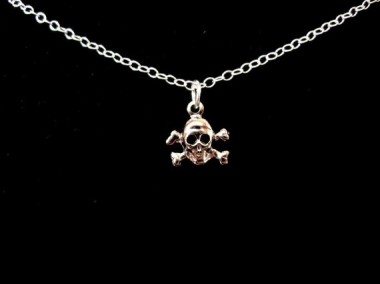 This minuscule skull and crossbones necklace by BasilTheCat is for when you want to be a dainty bad ass.