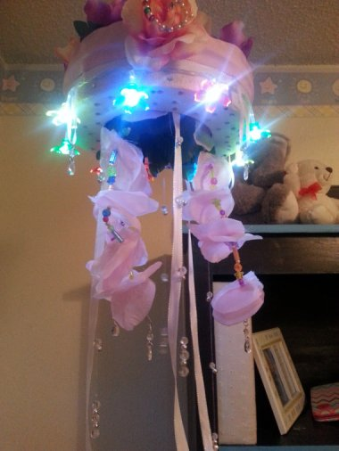 And on the other side of the, er, taste spectrum, here's a light-up baby mobile comprised, as far as I can tell, of stuff found at the bottom of some boxes in this lady's basement. By xoMoreSugarPleasexo