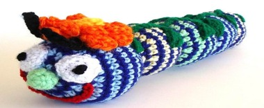 At a loss for what to give that special infant in your life? How about a scary knitted caterpillar with crazy eyes? By AllKindsOfArt
