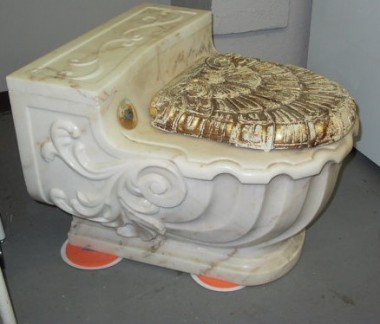 Gold-plated Italian marble toilet. The price tag of $7,499 is a drastic reduction because the gold is a little worn. CreativeCraftyGifts