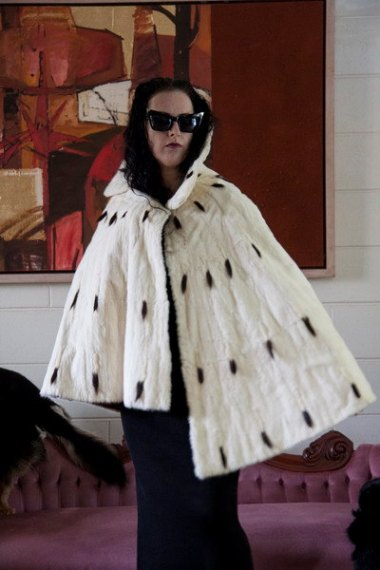 And $15,246.81 will get you this ermine cape, which wouldn't make you look bat-shit crazy at all. SyberGothess