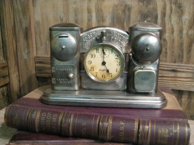 "This is a bit like the Hootenanny. ""Vintage Industrial Antique 1908 Darche Clock Flashlight Alarm Clock Safe Piggy Bank"" sold by VintageIronWorks"