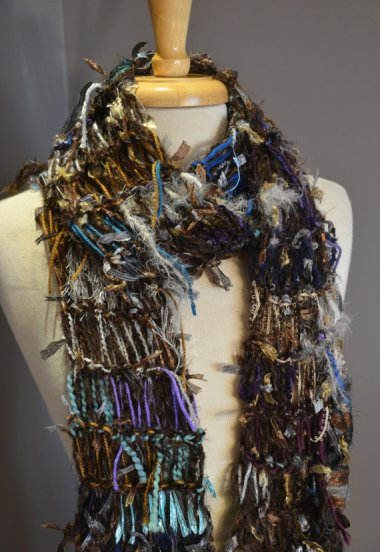 "This is one of many scarves made by __ in her ""Dumpster Divas"" line. I think you can assume they are made of actual garbage."