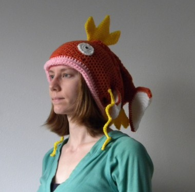 What makes this adult-sized fish hat (not words that should go together, by the way) hilarious to me is not just how dopey it is. It's also the complete joylessness of the woman wearing it, who, I suspect is either the maker or owes the maker money. By AdLibitumCrochet
