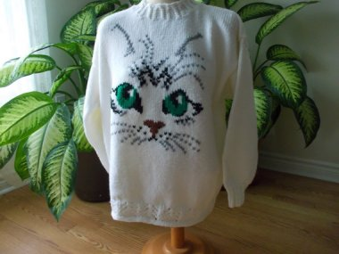 Say no to cat sweaters. By OmasBestKnits, which store is well stocked in the feline knitwear category