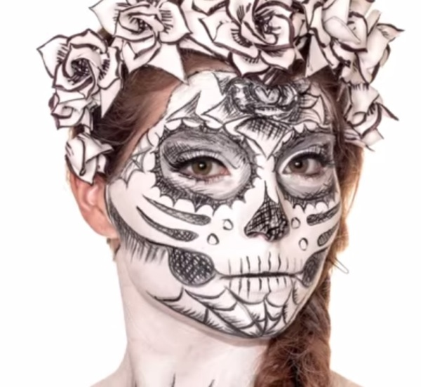Cross-hatched Calavera sugar skull makeup for Mexican Day of the Dead