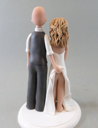 On the other hand, this topper is the wrong kind of memorable. By MudCards, embarrassing brides' mothers since 2010!