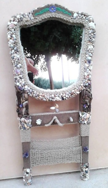 A mere $6,279.04 will put this upcycled entry mirror near your door. Presumably to scare away visitors. By ISeaThings