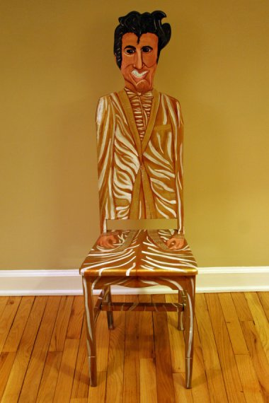 """""""50,000,000 fans can't be wrong"""" painted Elvis chair by FendosArt who clearly never saw a picture of Elvis"""