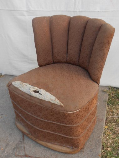 """""""Cute slipper chair"""" that """"needs a little attention."""" What it needs is to go back to the dumpster from whenceit came. Sold for $225 by KissMyATTVintage"""
