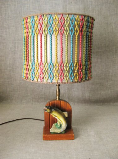 """I went looking for the ugliest vintage lamp on Etsy, and when I saw this thing, I stopped looking. $85 """"Rustic"""" fish lamp sold by WilShepherd"""