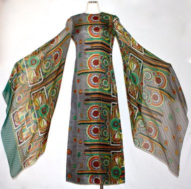 It's time for a treat. When I saw this 1960's Pierre Cardin silk gown, I nearly swooned! Sold by StatedStyle