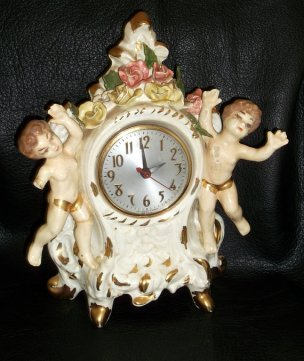 Those cherubs are looking suspiciously booby. Vintage porcelain eyesore sold by LoveAndLegacies