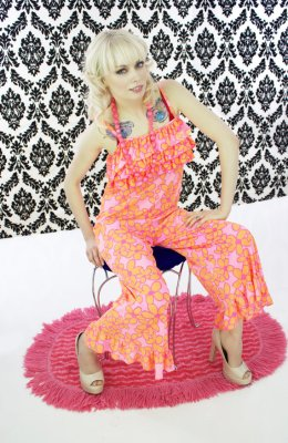 Sexy psychedelic romper. The model is sitting like she's trying to sneak one out. Sold by NeonThreadsDesigns