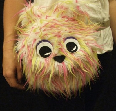 """Sexy """"Furry Critter Fanny Pack"""" sure to attract the opposite sex. Or the same sex. Or whatever it is you're trying to attract. Unless you're looking for adult partners, in which case you're shit out of luck. By RaveNation, which actually explains everything."""