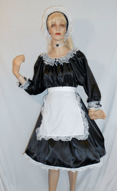 """On the other side of the spectrum, this """"Sexy English Style French Maid"""" (huh?) costume might have missed the sexy mark, but at least you're getting plenty of fabric for your money! By LaceyMaids"""