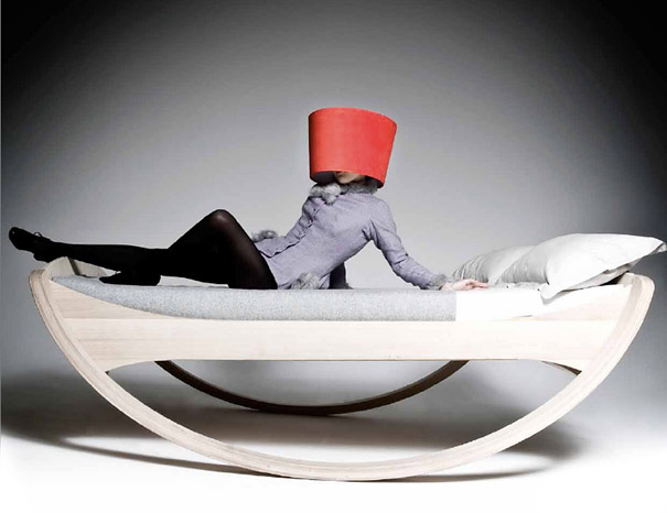 This is a rocking bed. It actually looks very comfortable, and I think it's quite stylish, too. I include the picture because the designer only put out pictures of models on the bed wearing lampshades on their heads.