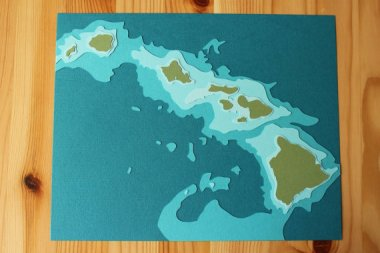 This relief map of the Hawaiian islands is actually a lovely souvenir. Except that it ships from Minneapolis. By Crafterall, who offers a few other locations as well