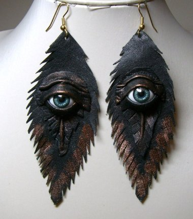 I don't know whether I'm more bothered by the fact that these earrings have eyes or the way they are mismatched. From LeasBoutique