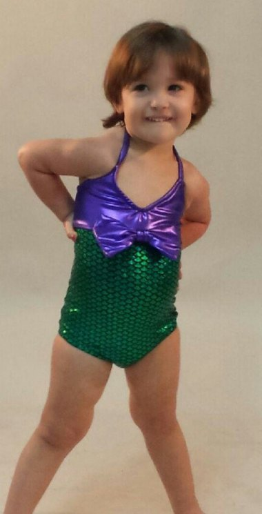 Let's start with something sweet for a change. How cute is this little girl in her mermaid suit? By TAILZmermaidGear (who also make great mermaid tails which I have purchased before)