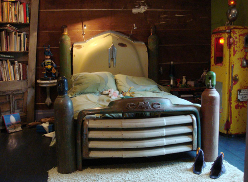 This bed made from a vintage truck is spectacular. Look at those lines!