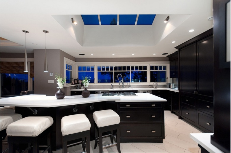 Ebony black and white modern kitchen by blurrdMEDIA