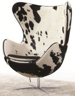As much as I love the iconic black and white hide chaise, I think the shape of this chair is actually a bit more eye-catching. Sold by Houzz