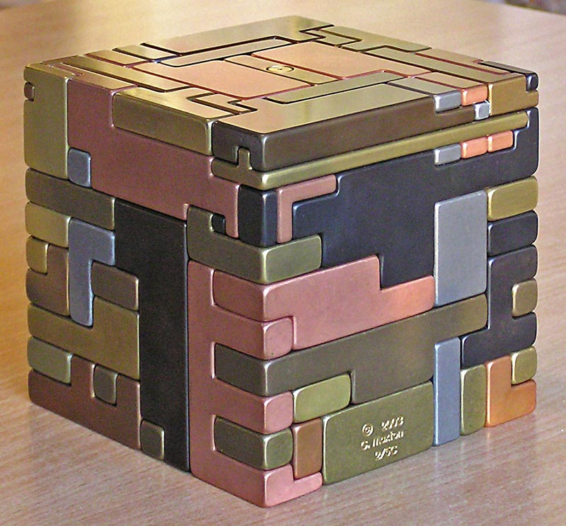 Labyrinth (42-piece, 30 lb. Japanese puzzle box requiring the correct sequence to open.) ©GarE Maxton