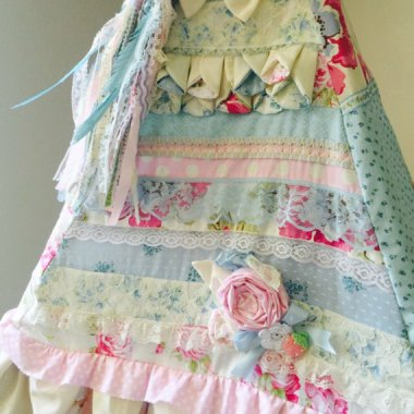 Does your house have cabbage rose prints on every surface? Is every small appliance covered in its own paste-colored cozy? Did you name your child Doily? Then we have just the teepee for you! By FrancieAndCo