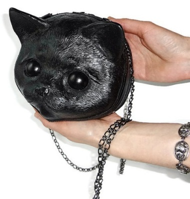 Oddly scary leather cat purse. By FamilySkiners