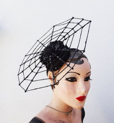 This is pretty cute as spider web hats go, but I can't help feeling like Barbie dries her clothes on that thing. By BatcakesCouture