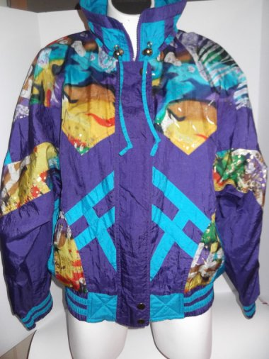 This may actually be the ugliest coat from the '80s, and that, as you know, is quite a tough title to win. By CarnivalofFASHION who specializes in awful vintage