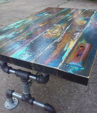 This is the coolest door-as-table I've ever seen. Love the patina! By trashstudio