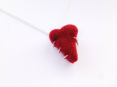 So cool! Now you can make a necklace of your vanquished enemy's tongue! What? It's a heart? That's disappointing. By RebeccasEmporium