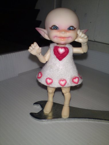 """This is a """"Be my Valentine"""" felt dress for a Realpuki doll. I have no idea what that is, but I'm feeling pretty pukey, myself. By RealPukiPukiLand"""