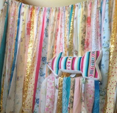 This may looks like a mismatched collection of fabric scraps tied together, but no. It's a boho headboard. Leave it to Etsy. By ChangesByNeci