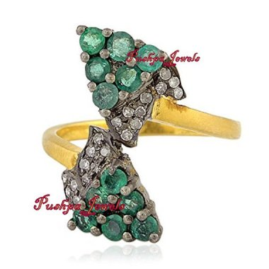 Perhaps the ugliest emerald/diamond ring in the history of finger adornments. Thats quite an achievement when you think about it. By HandmadeVictorian