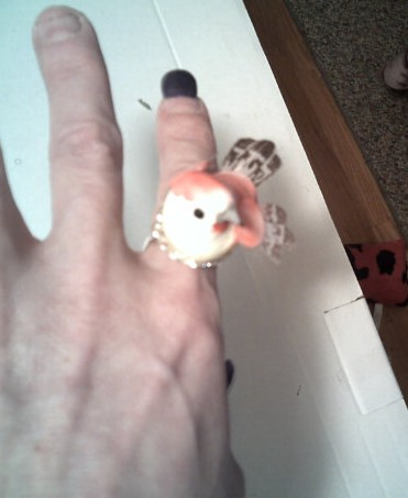 """Pretty Bird Ring"" which is listed as suitable for an engagement to a bird lover. Also, I'm pretty sure that's the Crypt Keeper modeling it. Yike on all fronts. By CathysCraftWorld"