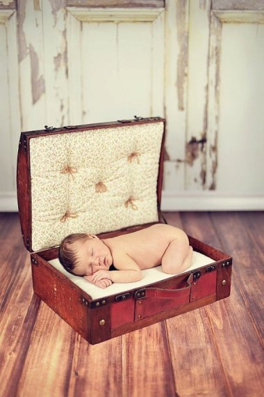 Don't be fooled. Babies may be travel-sized, but they're still a misery to travel with. Photo prop by CreaTiveDesiGns4
