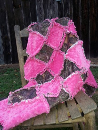 Pink and camo crib-sized quilt. (Shudder.) By Sewnbyangie