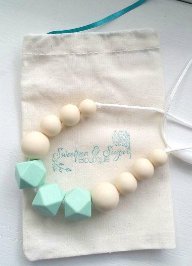 You know how babies love to pull and chew on your jewelry? Well, this is a silicone teething necklace that's both freezer and dishwasher safe. What a great idea! By Sweetpeasugarshop