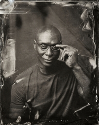 EXCLUSIVE PREMIUM RATES APPLY- Lance Reddick poses for a tintype (wet collodion) portrait at The Collective and Gibson Lounge Powered by CEG, during the 2014 Sundance Film Festival in Park City, Utah. (Photo by Victoria Will/Invision/AP)