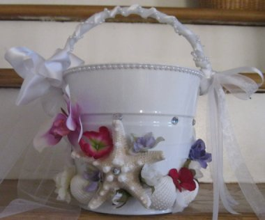 Exotic flower girl pail, presumably for her to vomit into.