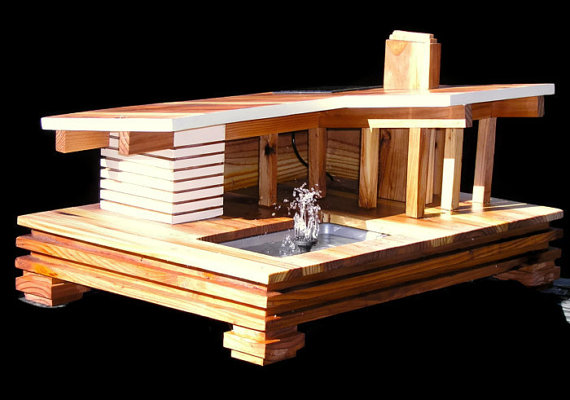 This one's got a working solar-powered water feature! By MidCenturyWoodShop