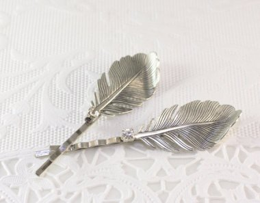I have a pair of hair pins very like these, and they're absolutely lovely! By mylavaliere