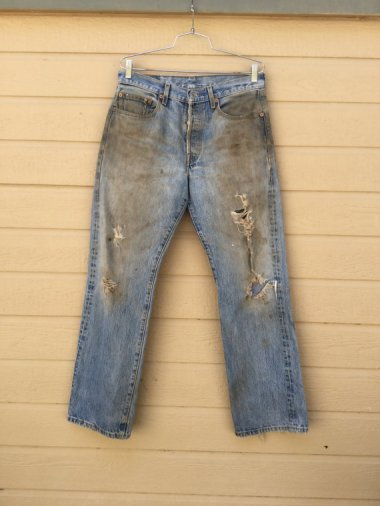 I wasn't allowed to have jeans when I was a kid. My mother called them 'dungarees' in a tone of voice that implied they came with actual dung on them. I suspect this is what she had in mind.