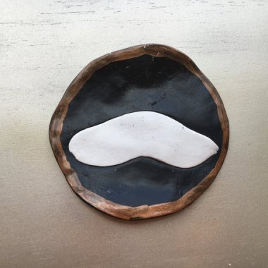 Mustache coaster that fails both as a mustache and a coaster.