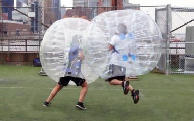 Set of 12 Bubble Ball Soccer Suits ($2,099). I so want to do this!