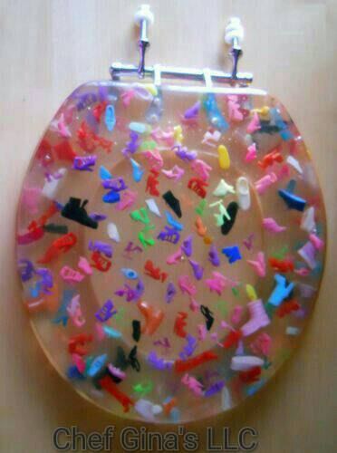 Always wanted Barbie to kick your ass? Well, you're in luck! $350 custom-made barbie shoe toilet seat. Because Etsy.